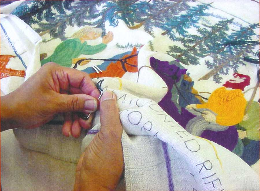 Stitching hands on the Fort Vancouver Tapestry